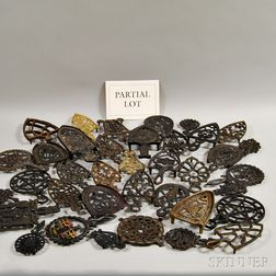 Approximately Forty-six Cast Iron and Brass Trivets