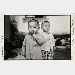 Mary Ellen Mark (American, 1940-2015)      Young Boy with Mickey Mouse Ears, Lutu Village, Yunnan Province, China
