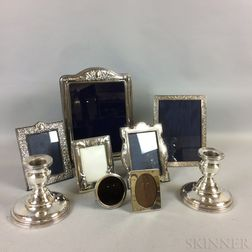 Seven Sterling Silver Frames and a Pair of Silver-plated Candlesticks