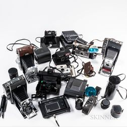 Collection of Polaroid Cameras, Accessories, and a Tripod