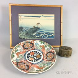 Satsuma Porcelain Charger, a Brass Cricket Box, and a Framed Japanese Woodblock Print.     Estimate $200-250