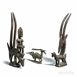 Three Bamana-style Carved and Cast Chi Wara Figures