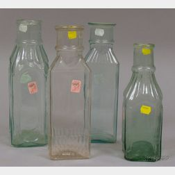 Four Aqua and Colorless Blown and Molded Glass Pickle Bottles