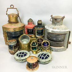 Thirteen Nautical Lights or Lanterns and a Ship's Compass