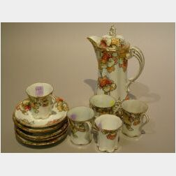 Twelve-Piece Nippon Floral Decorated Porcelain Chocolate Set.