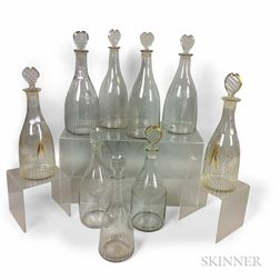 Nine Colorless Blown Glass Decanters with Heart-form Stoppers