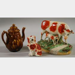 Two Staffordshire Figural Items and a Rockingham Glazed Teapot