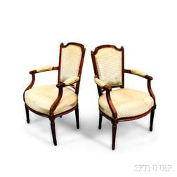 Pair of Louis XVI-style Upholstered Carved Walnut Fauteuil