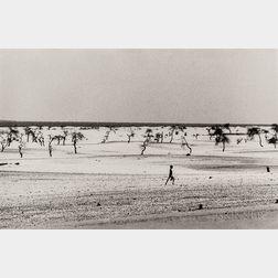 Sebastião Salgado (Brazilian, b. 1944)      Site of the Now Dried Lake Faguibine, Mali