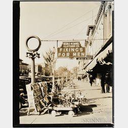 Walker Evans (American, 1903-1975)       Sidewalk Scene with Keeble-McDaniel Clothing Company Sign, Main Street, Selma, Alabama