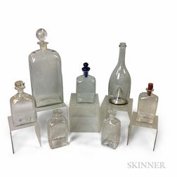 Seven Colorless Blown Glass Bottles and Decanters