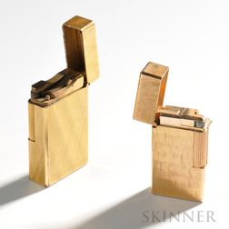 Two Gold-plated Lighters, one marked S.T. Dupont Hermes on the base and with a decorative body and a Vinci lighter with brushed surfa