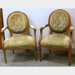 Near Pair of Louis XVI Style Upholstered Carved Beechwood Fauteuils.