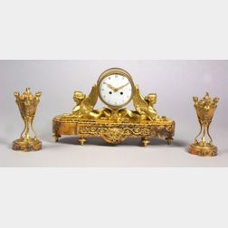 Egyptian Revival Three-Piece Gilt Bronze and Sienna Marble Clock Garniture