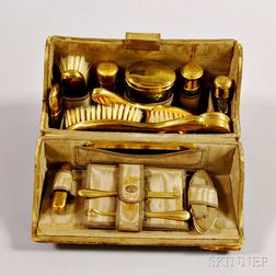 Cased and Brass-mounted Toiletry Set.     Estimate $200-250