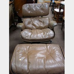 Charles and Ray Eames Tan Leather Upholstered Walnut Laminated Lounge Chair and Ottoman.