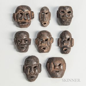 Eight Nepalese Carved Wood Maskettes