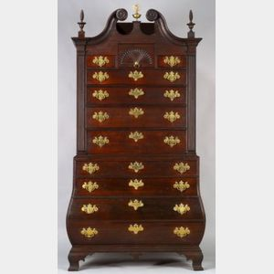 "Sold for: $1,766,000 - The Robert ""King"" Hooper Chippendale Mahogany Carved Scroll-top Bombe Chest-on-Chest"