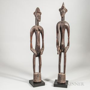 Two Senufo-style Carved Wood Male and Female Rhythm Pounders