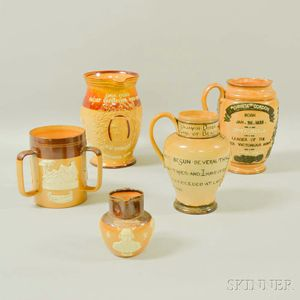 Four Royal Doulton and Doulton Lambeth Stoneware Commemorative Jugs and a Loving Cup