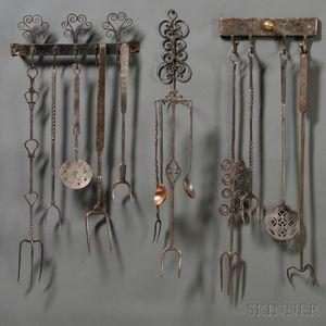 Three Wrought Iron Wall-mounted Racks with Thirteen Wrought Iron Utensils