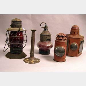Four Glass and Tin Lanterns and a Hogscraper Push-up Candlestick