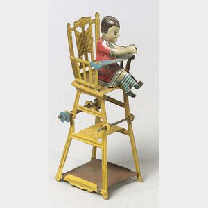 German Lithographed Tin Child in High Chair