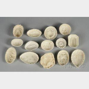 Fourteen Small Creamware Culinary Molds