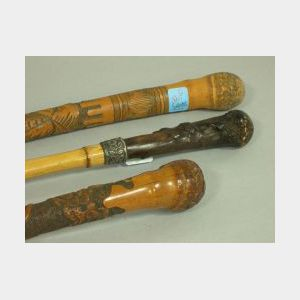 Two Carved Bamboo Walking Sticks and a Root and Sterling Mounted Bamboo Walking Stick.