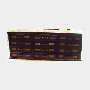 Mahogany Twelve-Drawer File Counter Cabinet.