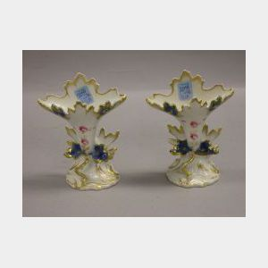 Pair of Gilt and Floral Decorated Porcelain Vases.
