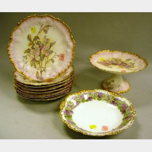 Set of Eight Limoges Gilt and Floral Decorated Porcelain Shaped Dishes and a Tazza