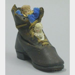 Two Bisque Figures in Leather Shoe,