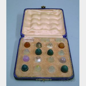 Sixteen Carved Multicolored Stone Game Pieces and Three Stone Marks