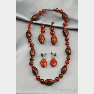 Cherry Amber and Carved Figural Bead Necklace