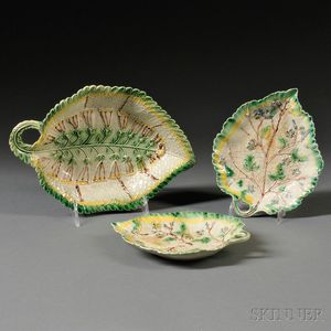 Three Staffordshire Cream-colored Earthenware Leaf-form Dishes