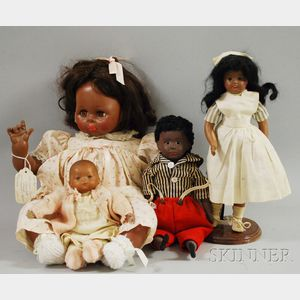 Four Miscellaneous Brown Dolls