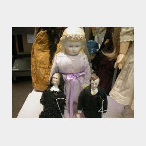Three Dolls by R. M. Brouse