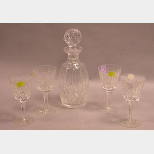 Waterford Colorless Cut Glass Decanter and Four Wine Glass Set.