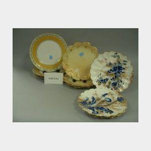 Set of Twelve Doulton Burslem Gilt Cobalt Floral Dessert Plates, Set of Eleven Royal Worcester Gilt Floral-form Dessert Plates and a Se