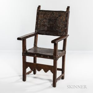 Renaissance-style Stamped Leather and Walnut Armchair