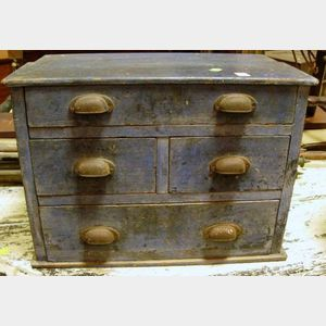 Small Blue Painted Four-Drawer Chest.
