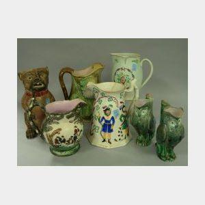 Four Majolica Jugs and Four Assorted English Ceramic Jugs