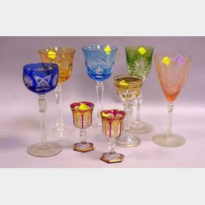Eight Assorted Colored Glass Wine Stems.