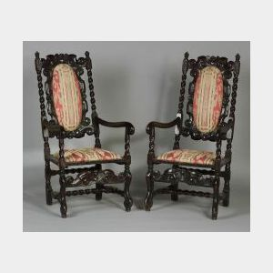 Pair of Jacobean Revival Carved Walnut Open Armchairs