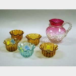 Set of Four Stevens & Williams Amber Jewel Pattern Ruffled Glass Bowls, a Single Blue Bowl, and an Amberina Glass Pitcher with Rope Han