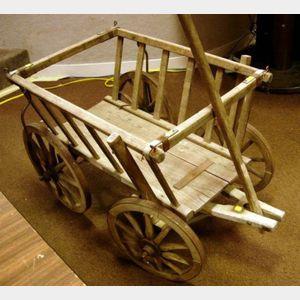 Small Wooden Wheelbarrow.