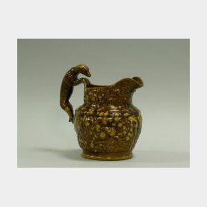 Rockingham Glazed Hound-Handled Ceramic Pitcher.