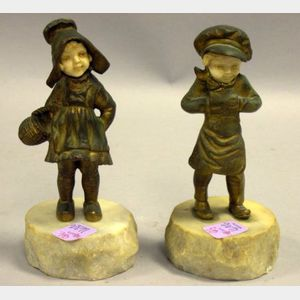 Pair of Gilt Cast Metal and Resin Dutch Boy and Girl Figures
