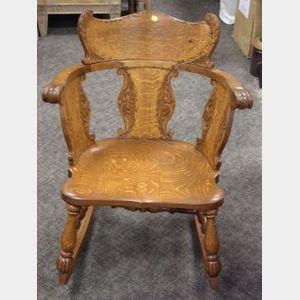 Late Victorian Carved Oak Armrocker.